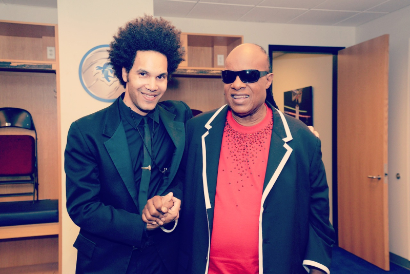Scott tixier with stevie wonder